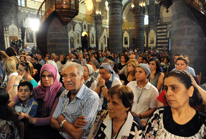 Syrian Christians attend a prayer vigil for peace at the Lady of Dormition, the Melkite Greek Catholic patriarchal cathedral in the Old City of Damascus, on September 7, 2013.(AFP Photo / STR)