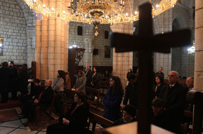 Syrian Christians attend Christmas Day mass at the Saint George Monastery in Mishtaya, some 50 kms from Homs, on December 25, 2011.(AFP Photo / Louai Beshara)