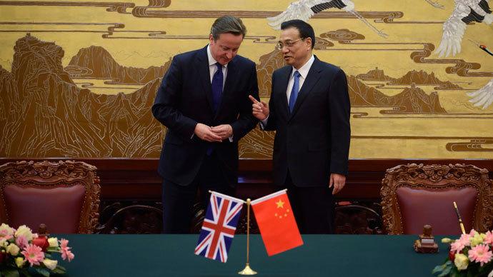 Salesman David Cameron makes up to China