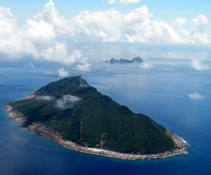 This aerial shot shows the disputed islands known as Senkaku in Japan and Diaoyu in China in the East China Sea. (AFP Photo / JIJI Press Japan out)