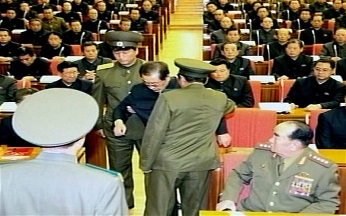The video shows Jang Song-Thaek reportedly being dragged from his chair by two police officials during a meeting in Pyongyang (YONHAP/AFP)