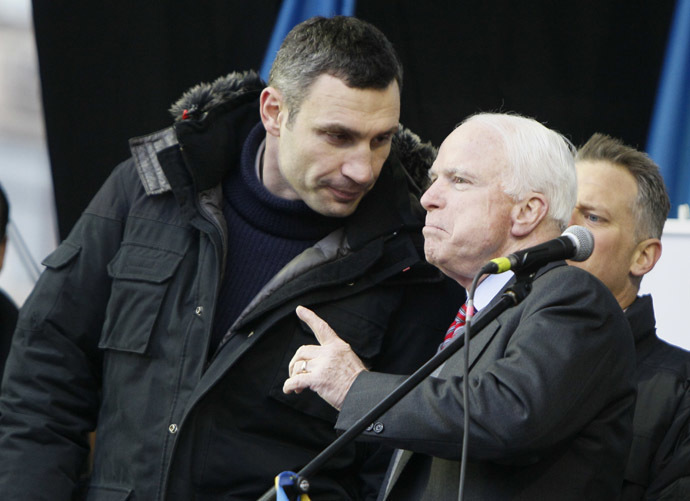 U.S. Senator John McCain (R) speaks with Ukrainian opposition leader Vitaly Klitschko (L) during a mass rally by pro-European integration protesters at Independence Square in Kiev December 15, 2013. (Reuters/Gleb Garanich)