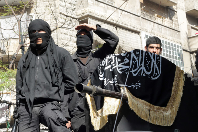 Members of jihadist group Al-Nusra Front take part in a parade calling for the establishment of an Islamic state in Syria, at the Bustan al-Qasr neighbourhood of Aleppo, on October 25, 2013. (AFP Photo)