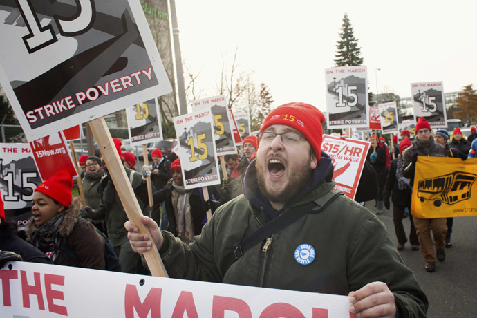 Aaron Sherman yells slogans in SeaTac, Washington during a protest march from SeaTac to Seattle aimed at the fast food industry and raising the federal minimum wage and Seattle's minimum wage to $15 an hour December 5, 2013. (Reuters/David Ryder)