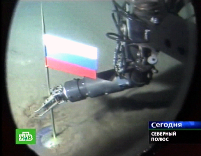 A Russian NTV channel grab taken 03 August 2007 shows a manipulator of the Mir-1 mini-submarine as it places a Russian state flag at the seabed of Arctic ocean at a depth of 4,261 meters (13,980 feet), 02 August 2007. (AFP Photo / NTV)