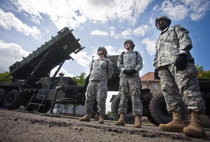 US soldiers stand in front of a Patriot missile battery at an army base in the northern Polish town of Morag (AFP Photo/ Wojtek Radwanski)
