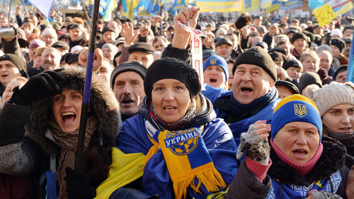 Protesters shout slogans during a rally of the opposition on Independence Square in Kiev on December 22, 2013. (AFP Photo / Genya Savilov)