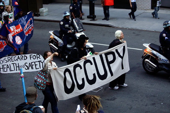 Occupy Wall Street protesters march along 47th Street in New York September 17, 2013.(Reuters / Joshua Lott)