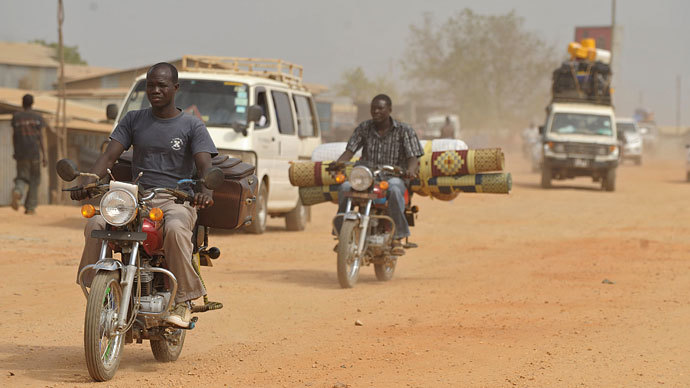 Residents of Juba with their belongings ride out of the city on December 21, 2013 where tension remains high fueling an exodus of both local and foreign residents from the south Sudanese capital.(AFP Photo / Tony Karumba)