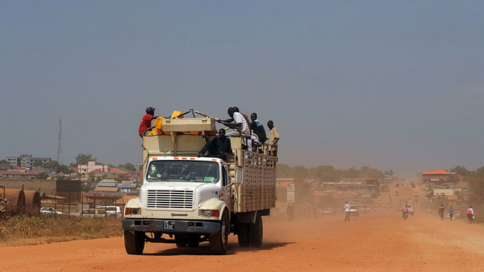 South Sudanese sit on a truck with their belongings as it heads out of Juba on December 21, 2013 where tension remains high fueling an exodus of both local and foreign residents from the south Sudanese capital.(AFP Photo / Tony Karumba)