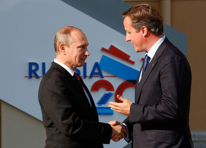 Russia's President Vladimir Putin (L) welcomes Britain's Prime Minister David Cameron before the first working session of the G20 Summit in Constantine Palace in Strelna near St. Petersburg, September 5, 2013.(Reuters / Grigory Dukor)