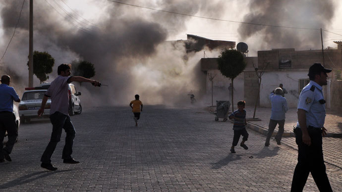 Smoke rises from the explosion area after several Syrian shells crashed inside Akcakale town in Turkey, killing at least five people on October 3, 2012, in Sanliurfa. Many.(AFP Photo / Rauf Maltas)