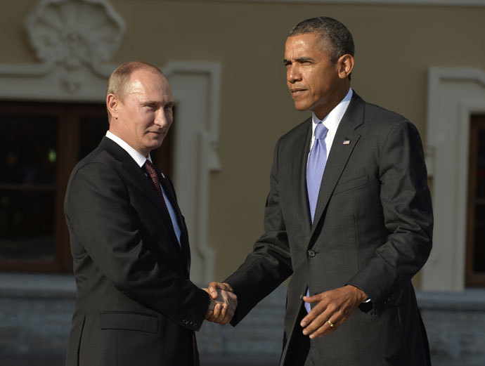 Russia's President Vladimir Putin welcomes US President Barack Obama at the start of the G20 summit on September 5, 2013 in Saint Petersburg.(AFP Photo / Eric Feferberg)