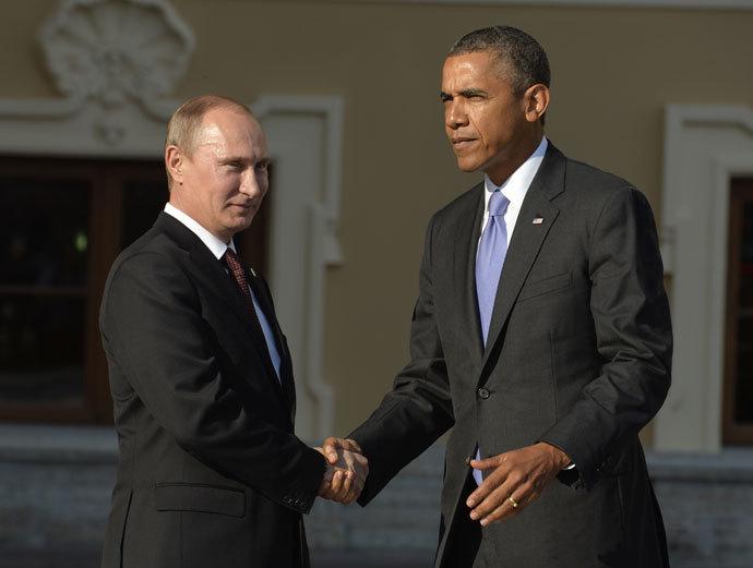 Russia's President Vladimir Putin welcomes US President Barack Obama at the start of the G20 summit on September 5, 2013 in Saint Petersburg.(AFP Photo / Eric Feferberg)