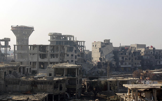 Damaged buildings are seen in the Damascus suburb of Arbeen January 1, 2014. (Reuters/Ammar Al-Erbeeni)