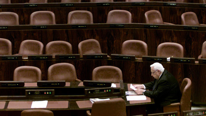 Israeli Prime Minister Ariel Sharon sits in the Knesset, or parliament, before the opening of the winter session October 15, 2001.(Reuters / Natalie Behring)