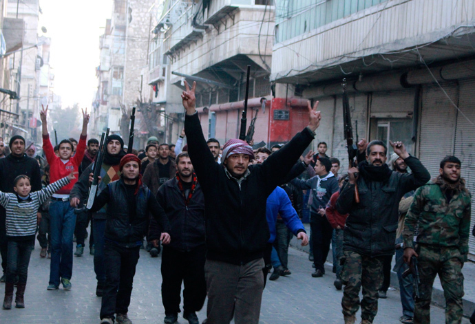 Civilians accompanied by Free Syrian Army fighters gesture as they march during a protest against fighters from the Islamic State in Iraq and the Levant (ISIL) in the Kadi Askar neighbourhood of Aleppo January 7, 2014. (Reuters / Abdalrhman Ismail)