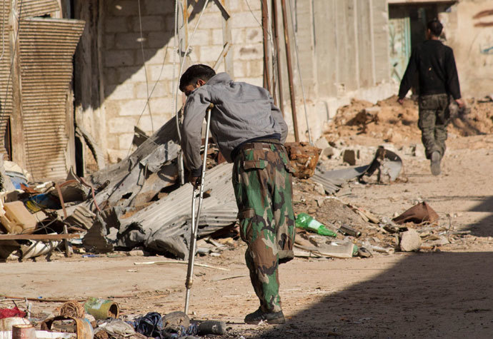 A Free Syrian Army fighter, with an amputated leg, walks with a crutch in Daraya, near Damascus January 15, 2014.(Reuters / Hussam Zeen)