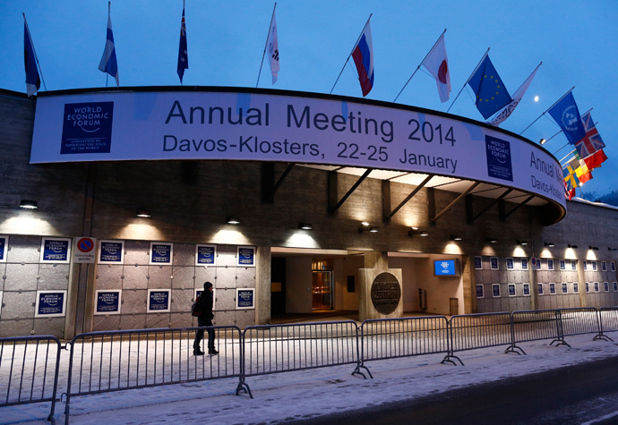 A person walks past the entrance of the congress centre for the annual meeting of the World Economic Forum (WEF) 2014 in the early morning in Davos January 21, 2014. (Reuters / Ruben Sprich)