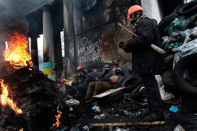 Kiev, 28 de janeiro de 2014.  (AFP Photo / Aris Messinis)