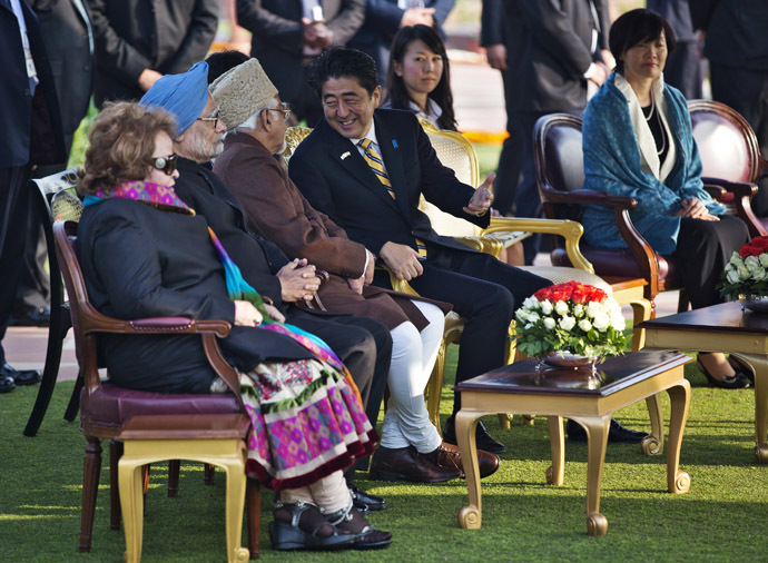 "Japan's Prime Minister Shinzo Abe (C) speaks with Indian Vice President Hamid Ansari as his wife Akie (R) and Indian Prime Minister Manmohan Singh (2nd L) look on, while attending the ""At Home"" reception at the Rashtrapati Bhavan presidential palace after the Republic Day parade in New Delhi January 26, 2014. (Reuters)"