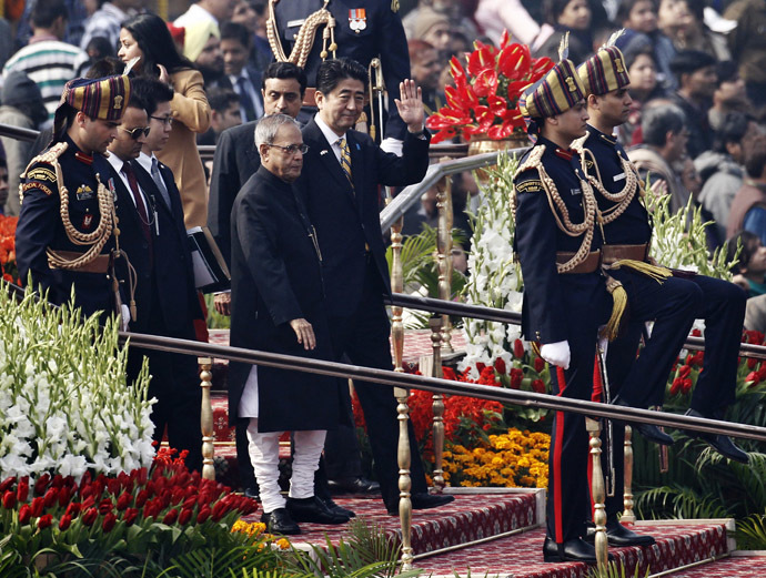 Japan's Prime Minister Shinzo Abe (centre R) waves as he walks with Indian President Pranab Mukherjee (centre L) as they leave after attending the Republic Day parade in New Delhi January 26, 2014. (Reuters)