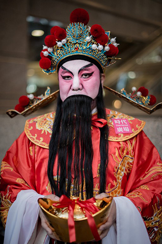 A man wears a traditional costume during an event celebrating the upcoming Year of the Horse, outside a shopping mall in Hong Kong. (AFP Photo / Philippe Lopez)