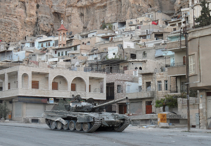 A Syrian army tank is seen in the Christian town of Maalula on September 11, 2013 (AFP Photo / STR)