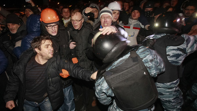 Opposition activists clash with riot police as they block police buses near a court in Kiev (Reuters)