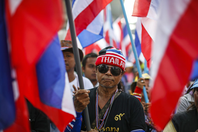 An anti-government protester takes part in a rally in central Bangkok January 30, 2014. (Reuters/Athit Perawongmetha)