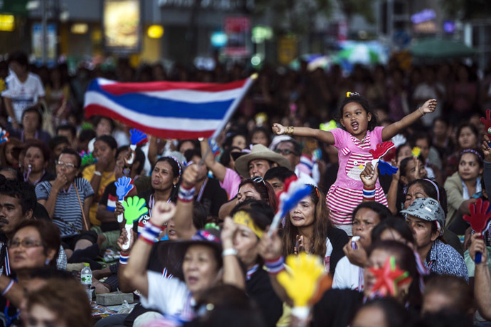 A girl reacts as she gathers with anti-government protesters while protest leader Suthep Thaugsuban (not pictured) speaks during a rally in central Bangkok, January 28, 2014. (Reuters/Nir Elias)