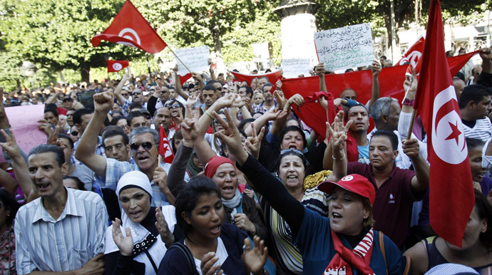 Protesters shout slogans during a demonstration after seven policemen were killed during clashes last week in Sidi Bouzid, as they gather at the central Habib Bourguiba Avenue in Tunis October 28, 2013. (Reuters)