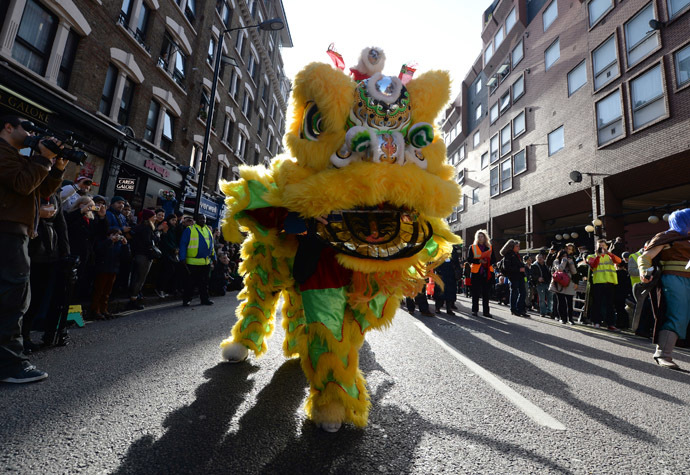Revellers dressed in traditional costume perform during a parade celebrating Chinese New Year, the Year of the Horse, in central London February 2, 2014. (Reuters/Neil Hall)
