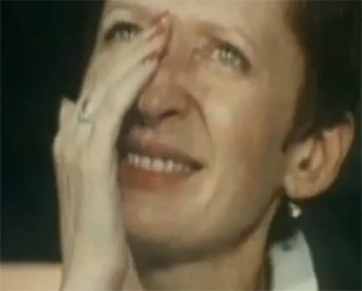 A spectator wiping her tears at the 1980 Summer Olympic Games in Moscow (screenshot from youtube.com)