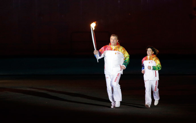 Former hockey player Vladislav Tretiak (L) and figure skater Irina Rodnina run to light the Olympic cauldron during the opening ceremony of the 2014 Winter Olympics in Sochi February 7, 2014 (Reuters / Matt Slocum)