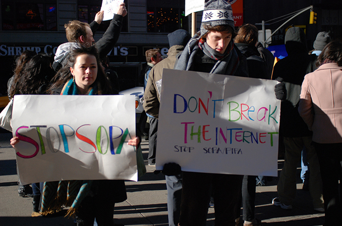 An activists hold a placard during a rally against SOPA, New York. (Photo by Alain-Christian / flickr.com)