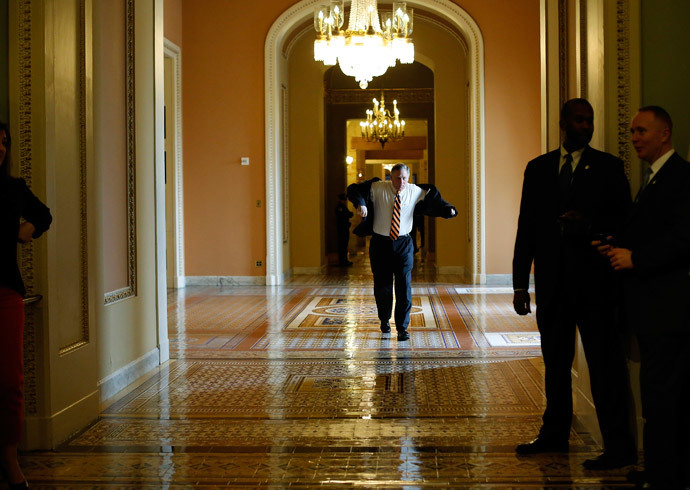 U.S. Senator Richard Burr (R-NC) walks from a Republican caucus meeting to the Senate floor for a vote on whether to raise the debt ceiling, at the U.S. Capitol in Washington February 12, 2014.(Reuters / Jonathan Ernst)