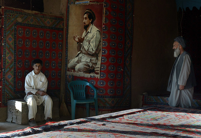 The operators of a tea house with a big portrait of Afghan hero Ahmad Shah Masoud (Reuters / Caren Firouz)