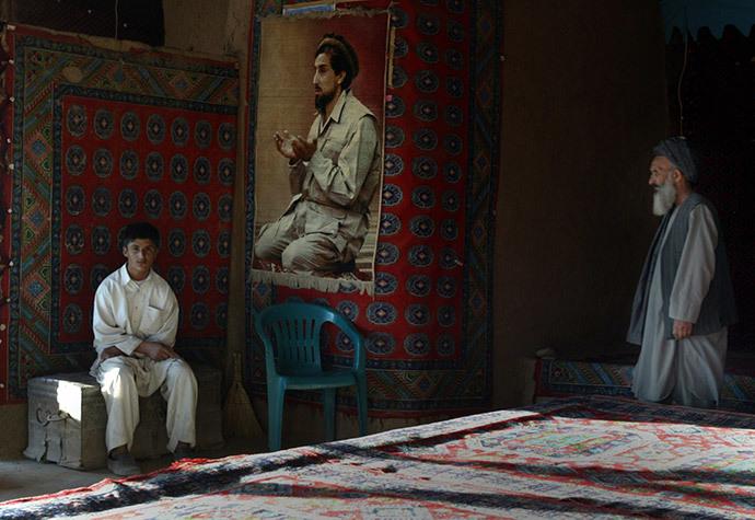 The operators of a tea house with a big portrait of Afghan hero Ahmad Shah Masoud (Reuters / Caren Firouz)