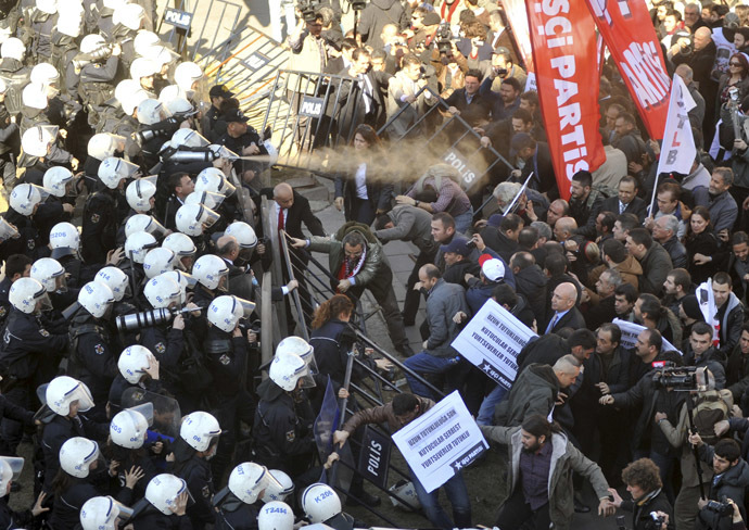 Riot police use tear gas and water canon to disperse protesters as they try to march to the parliament during a protest against Turkey's ruling Ak Party (AKP) and Prime Minister Tayyip Erdogan in Ankara February 13, 2014. (Reuters)