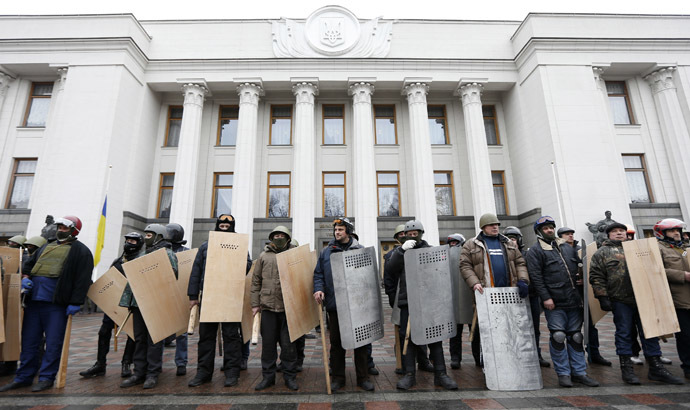 Anti-government protesters hold shields as they guard the Ukrainian Parliament building in Kiev February 22, 2014. (Reuters/Vasily Fedosenko)