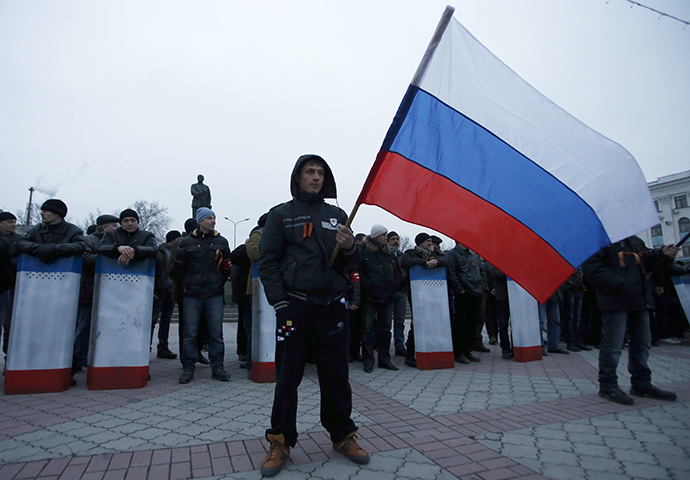 A man holds the Russian flag during a pro-Russian rally in Simferopol, Crimea March 1, 2014. (Reuters / David Mdzinarishvili)