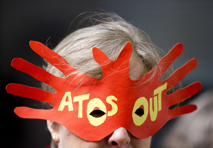 A protester demonstrates against IT company Atos's involvement in tests for incapacity benefits outside the Department for Work and Pensions in London (Reuters/Neil Hall)