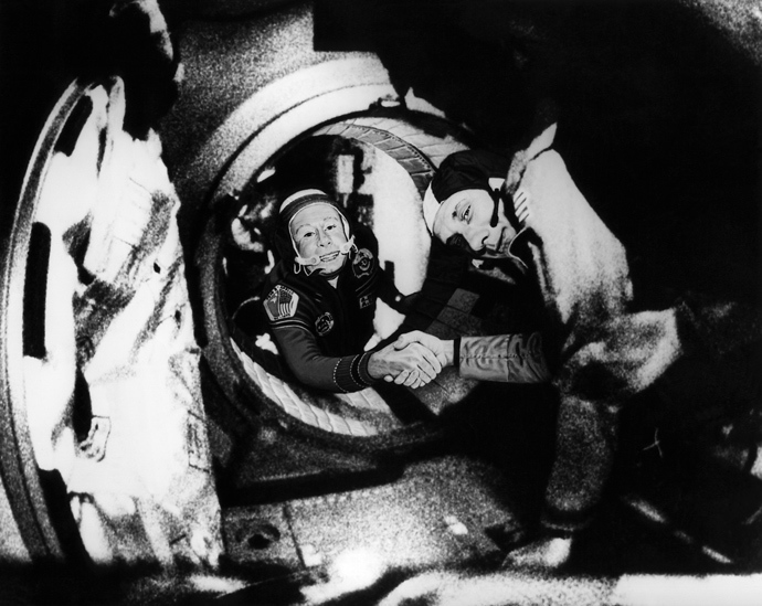 Commander of the Soviet crew of Soyuz, Alexei Leonov (L) and commander of the American crew of Apollo, Thomas Stafford (R), shake hands 17 July 1975 in the space, somewhere over Western Germany, after the Apollo-Soyuz docking manoeuvres (AFP Photo)