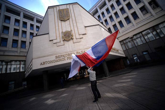 A Russian flag blows inside the entrance of Crimea's regional parliament building in Simferopol on March 13, 2014.(AFP Photo / Filippo Monteforte )