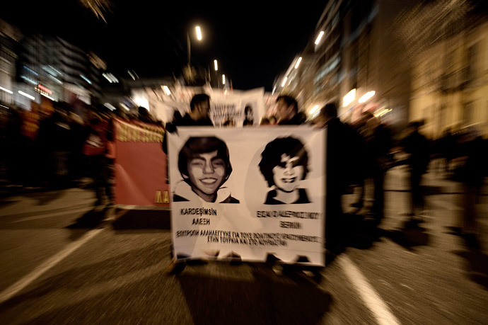 Protesters hold pictures during a demonstration after the death of Berkin Elvan, the 15-year-old boy who who died nine months after he was hit by a tear gas canister while going to buy bread during the protests in Istanbul last year, during a demonstration in Athens on March 13, 2014.( AFP Photo / Aris Messinis)