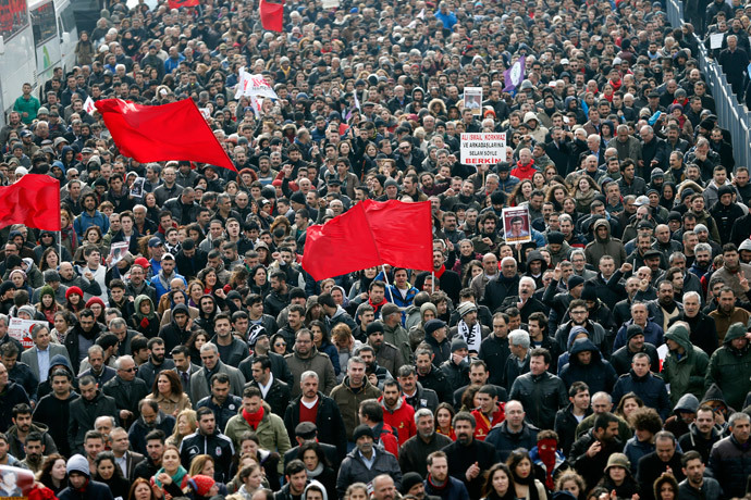 Mourners march as they follow the coffin of Berkin Elvan during funeral ceremony in Istanbul March 12, 2014.(Reuters / Murad Sezer)