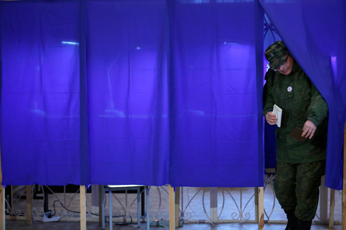 A man leaves a voting booth to cast his ballot during the referendum on the status of Ukraine's Crimea region at a polling station in Sevastopol March 16, 2014.(Reuters / Baz Ratner)