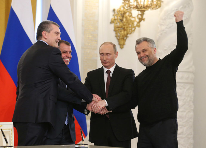 Russia's President Vladimir Putin (2nd R), Crimea's Prime Minister Sergei Aksyonov (L), parliamentary speaker Vladimir Konstantinov (2nd L) and Sevastopol Mayor Alexei Chaliy shake hands after a signing ceremony at the Kremlin in Moscow March 18, 2014. (Reuters / Yekaterina Shtukina / RIA Novosti / Pool)