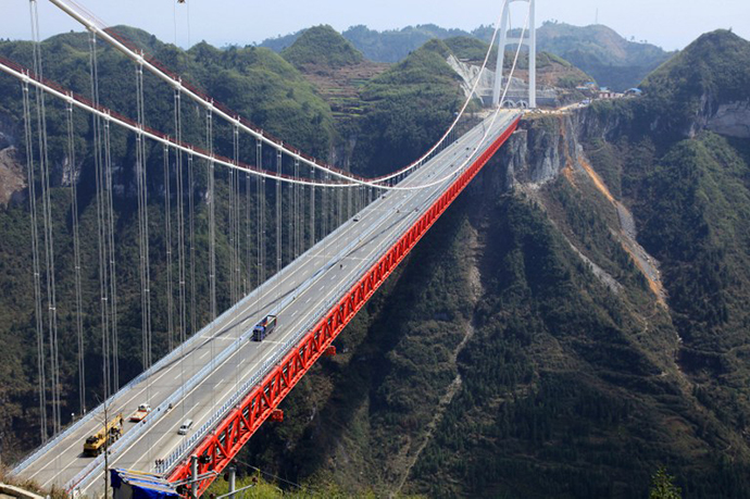 The Aizhai bridge, the worldís highest tunnel to tunnel bridge, at 336 meter-high (1,102 feet) and spanning 1,176 meters (3,858 feet), officially opens to traffic in Jishou, central China's Hunan province on March 31, 2012. (AFP Photo)